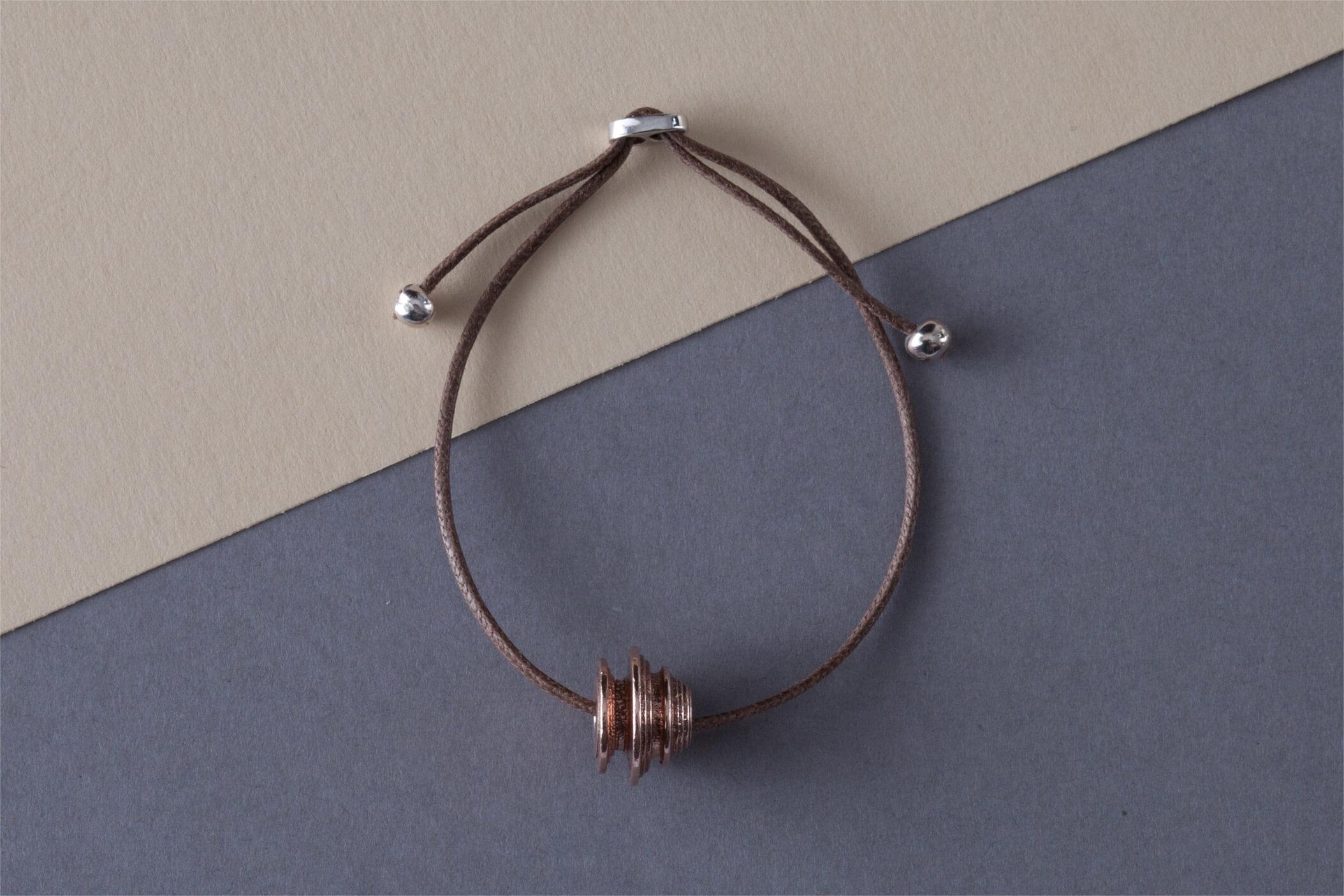 Bracciale in bronzo bagnato oro rosa chiusura con perline argento